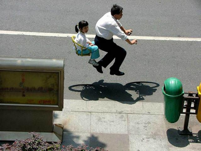 People riding invisible bikes by zhao huasen 2
