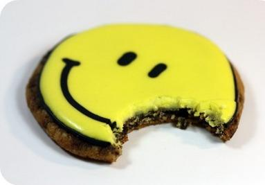 Happy Face Decorated Cookie With Bite In It