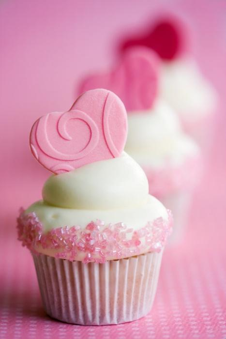 Cupcakes decorated with fondant hearts and pink sugar